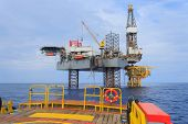 Offshore Jack Up Drilling Rig Over The Production Platform In The Middle Of The Sea - View From Crew