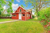 picture of tree trim  - Small coutnryside house exterior in bright red color with white trim - JPG