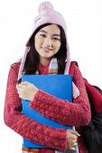 Girl In Woolen Clothes Holds Folder