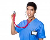 Asian Doctor use of stethoscope