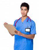 Doctor write on clipboard