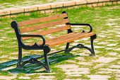 Empty Wooden Bench Standing In The Park On A Sunny Day