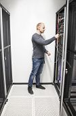 IT engineer connecting network in datacenter