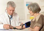 Elderly doctor measuring