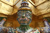 The Golden Pagoda And Yak Statue At The Phra Kaew, Bangkok,thailand