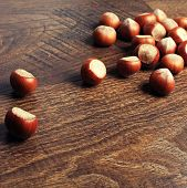 Hazelnuts On Wood Background