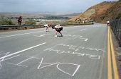 Fans chalk messages on road