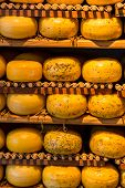 pic of meals wheels  - Cheese wheels on the shelves in Amsterdam store