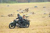 armed soldiers drive on motorbike
