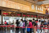 TAIPEI - Nov 21 : Lobby of Taipei Station with tourists and tickets vending machine in November 21, 2014 in Taipei, Taiwan.