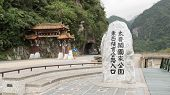 TAROKO, TAIWAN - DECEMBER 2nd : Famous memorial stone stand at the starting point of East-West Cross-Island way and many tourists take pictures here on November 2nd, 2014 in Taroko, Taiwan.