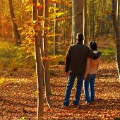Young Couple In Forest While Autumn