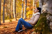 Woman Relaxing In Nature While Autumn Season