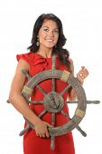 Young businesswoman holding ship wheel isolated over white background