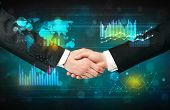 Handshake with charts and diagrams background