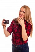 image of humiliation  - Attractive female photographer holding compact camera and humiliating it  - JPG