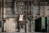 picture of fuse-box  - Industrial fuse boxes against damaged wall closeup - JPG