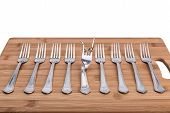 Abstraction Of The Kitchen Forks And One Fork Bending. Individualism.