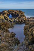 Little Inflow Of Water In The Sea Cliffs. Seascape.