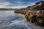 Sea Cliffs In Albufeira And The Beautiful Beach In Portugal.