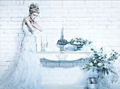 picture of snow queen  - Beautiful girl in white dress in the image of the Snow Queen with a crown on her head - JPG