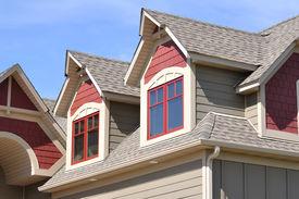 stock photo of gabled dormer window  - Gable Dormers and Roof of Residential House - JPG