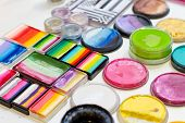 image of pastel  - Selection of various vibrant and pastel color palettes for face and body painting selective focus - JPG