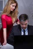 stock photo of inappropriate  - Young beautiful secretary talking with her handsome boss - JPG