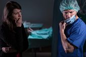 picture of bereavement  - Surgeon talking with woman about her husband - JPG