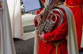 pic of parade  - A musician playing a tuba in a sacred week procession and parade - JPG