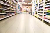 stock photo of grocery store  - Shelves with goods inside a large supermarket