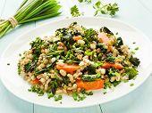 stock photo of nettle  - Boiled pearl barley with nettle carrot and leek - JPG