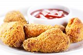 picture of southern fried chicken  - fried chicken with sauce on a plate  - JPG