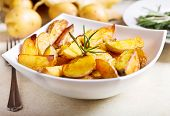 image of potato-field  - a bowl of roasted potatoes with rosemary