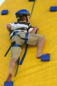 Child Climbing A Climbing Wall