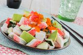 stock photo of masago  - Deconstructed California roll poke made with imitation crab cucumber avocado and capelin roe - JPG
