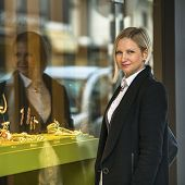 picture of jewel-case  - Woman near shop window with jewels - JPG