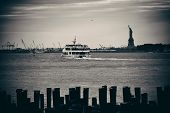 image of statue liberty  - Statue of Liberty at New York City harbor with pier - JPG