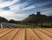 pic of unique landscape  - Unique time lapse stack landscape of medieval castle and railway tracks with wooden planks floor - JPG