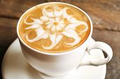 foto of latte  - Cup of coffee latte art on wooden table - JPG