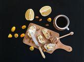 stock photo of kumquat  - Breakfast set on black backdrop - JPG