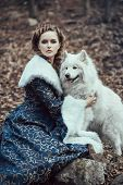 picture of hound dog  - The woman in blue coat walk with a dog - JPG
