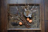 pic of willow  - Willow branches with egg on an old vintage wood from willow - JPG