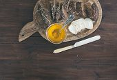 image of brie cheese  - Breakfast set on a dark wood background - JPG