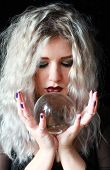 stock photo of witch ball  - Portrait of a stunning woman holding a crystal ball - JPG