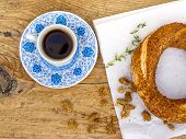 stock photo of bagel  - A cup of Turkish coffee and a sesame bagel on a wooden desk - JPG