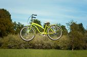 stock photo of levitation  - Bike levitates in the park over the meadow - JPG