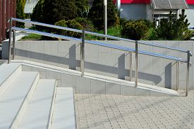picture of wheelchair  - Ramp for wheelchair entry with metal handrails - JPG