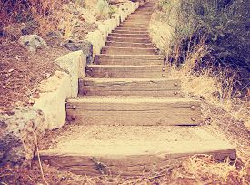 stock photo of step-up  -  wooden steps going up a hill toned with a retro vintage instagram filter effect app or action  - JPG