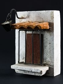 stock photo of pumice-stone  - lamppost above door with iron grill pumice - JPG